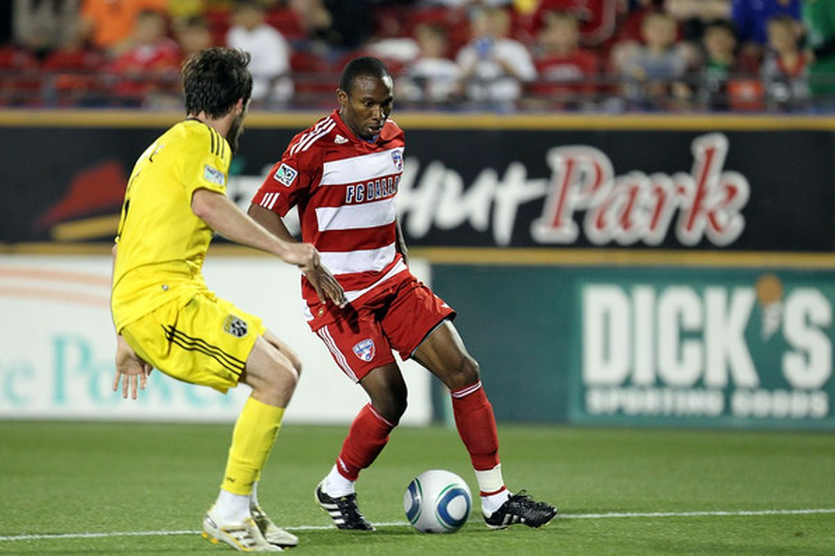 FRISCO, TX - APRIL 10:  Forward Jeff Cunningham #9 of FC Dallas dribbles the ball against Danny O'Rourke #5 of the Columbus Crew at Pizza Hut Park on April 10, 2010 in Frisco, Texas.  (Photo by Ronald Martinez/Getty Images)