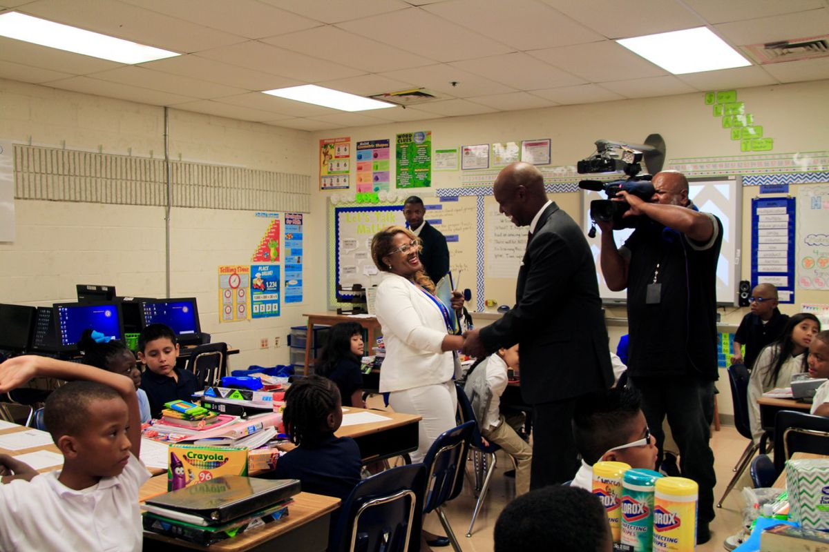 Superintendent Dorsey Hopson greets a third-grade teacher on the first day of school at Bruce Elementary School in Memphis.