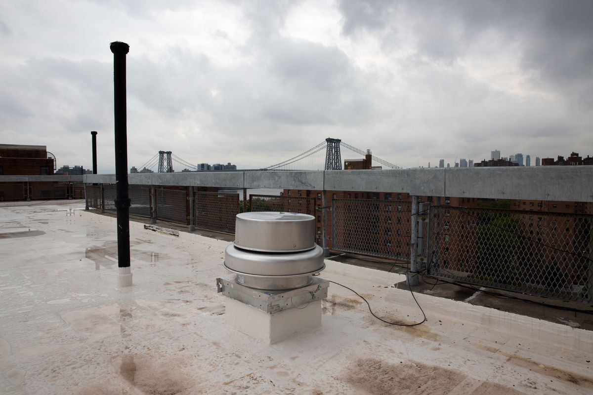 NYCHA installed a ventilation fan on the roof of a Wald Houses building, Aug. 19, 2020.