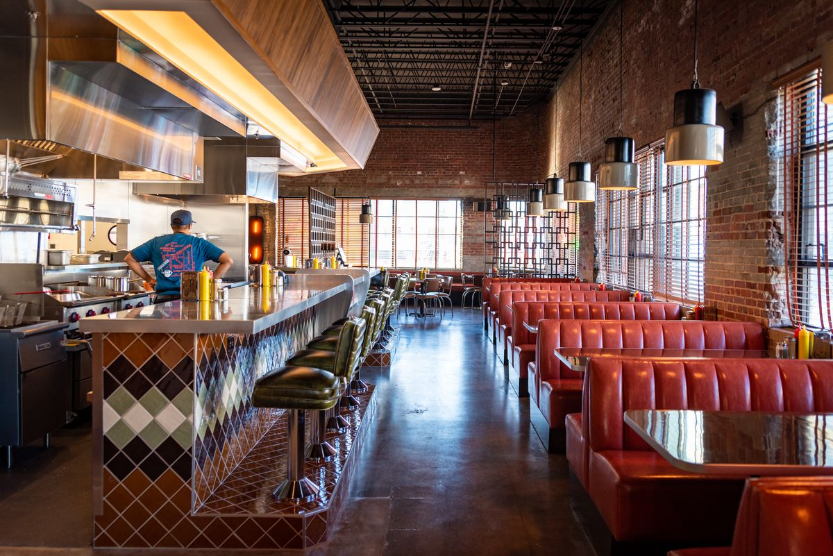 A long shot of the old school diner counter and row of booths at Wonderkid at Atlanta Dairies