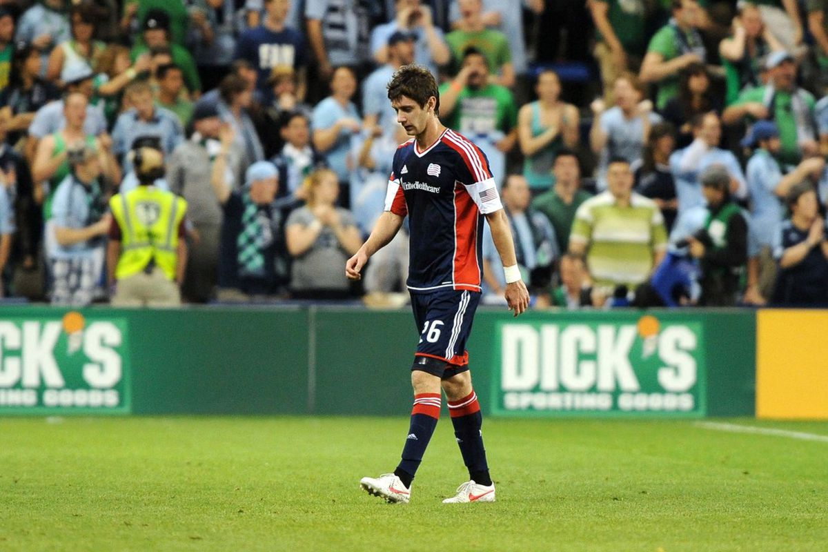 A dejected Stephen McCarthy leaves the pitch after referee Silviu Petrescu showed him a straight red card in the 14th minute of the New England Revolution's match against Sporting Kansas City on March 17th, 2012.