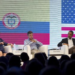 Brazil's President Dilma Rousseff, left, Colombia's President Juan Manuel Santos, center, and U.S. President Barack Obama participate in a three-way conversation at the CEO Summit of the Americas, in Cartagena, Colombia, Saturday April 14, 2012. Regional business leaders are meeting parallel to the sixth Summit of the Americas which brings together presidents and prime ministers from Canada, the Caribbean, Latin America and the U.S.