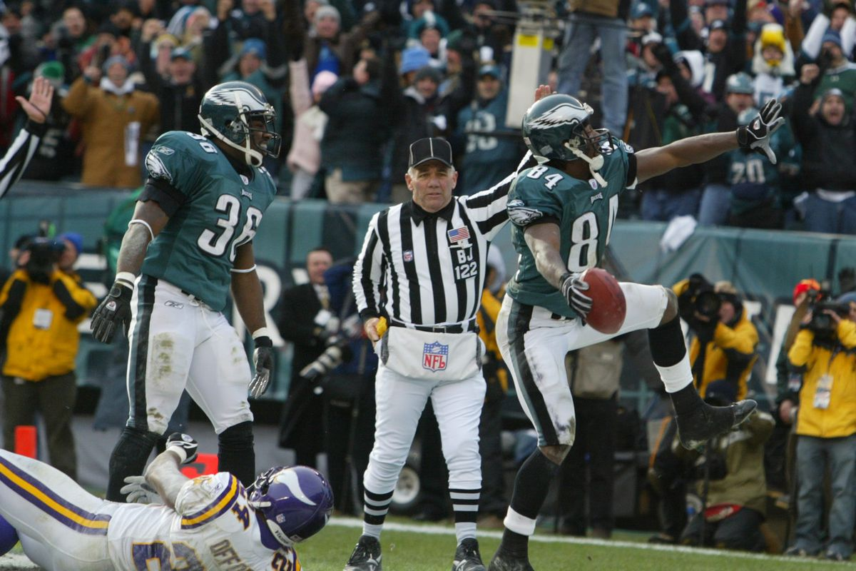 Jerry Holt/Star Tribune 1/16/2005 Vikings at Philly-------Philadelphia Eagles receiver Freddie Mitchell celebrated his 2nd quarter touchdown catch, after his teammate L.J. Smith fumble the football in the end zone and Mitchell caught the ball in the air.