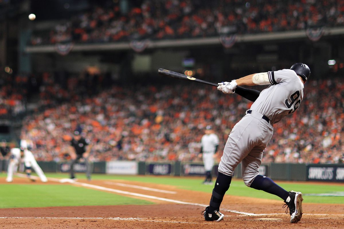 Aaron Judge #99 of the New York Yankees hits a two-run home run during the fourth inning against the Houston Astros in game two of the American League Championship Series at Minute Maid Park on October 13, 2019 in Houston, Texas.