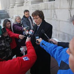 Peggy Tomsic, the attorney who represents the three couples, speaks with reporters outside the Frank E. Moss United States Courthouse Wednesday, Dec. 4, 2013, in Salt Lake City. A challenge to Utah's same-sex marriage ban by three gay couples is back in court Wednesday as a federal court judge heard arguments in a case being closely watched around the country.