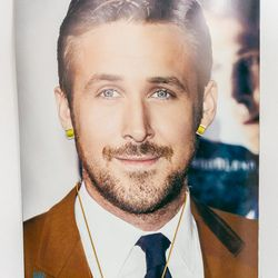 """Someone ordered a Ryan Gosling calendar as a joke because we needed a big calendar to get our schedule sorted. When it arrived, the actual 'calendar' was 1.5"""" x 4"""" in the bottom corner. Womp Womp. In the spirit of recycling, he now models our jewels for u"""