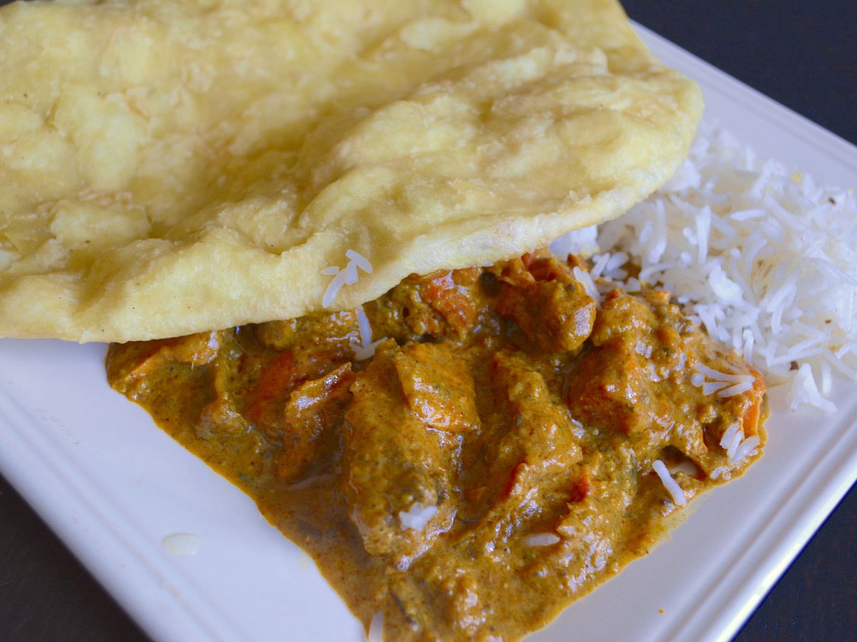 Indian chicken curry and bhatura.
