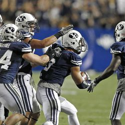 Brigham Young Cougars linebacker Kyle Van Noy (3) celebrates with team mates after he made an interception as the University of Utah and Brigham Young University play football Saturday, Sept. 17, 2011, in Provo, Utah.