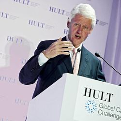 COMMERCIAL IMAGE - In this photograph taken by AP Images for Hult International Business School, Former President Bill Clinton awards $1 million prize to help solve poverty at the Hult Global Case Challenge on Thursday, April 26, 2012 in New York.
