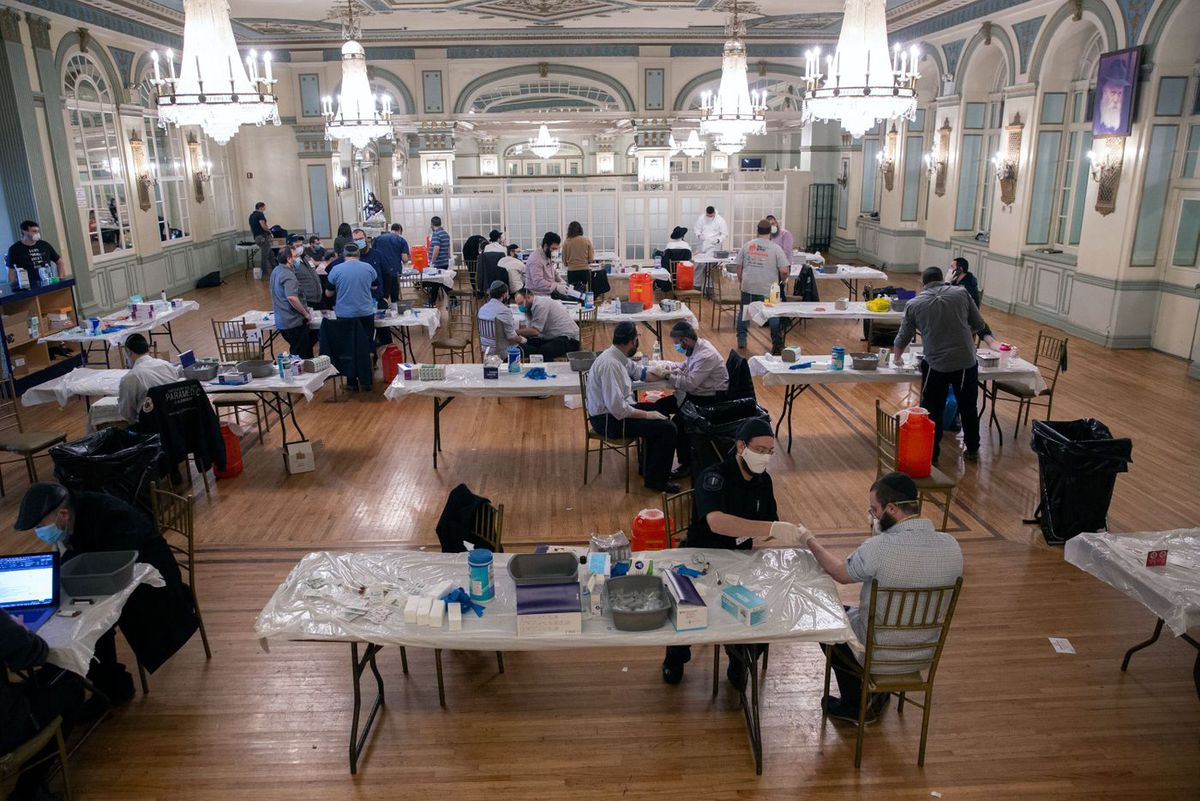 Crown Heights residents take part in a plasma-testing drive at the Oholei Torah Ballroom on Eastern Parkway.