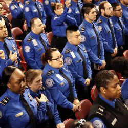 TSA officers stand during the public memorial service for slain TSA officer Gerardo Hernandez, Tuesday, Nov. 12, 2013. Hernandez was the first TSA officer killed in the line of duty when a gunman pulled a rifle from a bag and shot the 39-year-old father of two on Nov. 1, at Los Angeles International Airport. Two TSA officers and a teacher were injured before airport police wounded the gunman, Paul Ciancia.