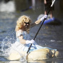 Robb Boumann dressed up like Cinderella while competing in the 2013 Mountain Valley Seed Co. Ginormous Pumpkin Regatta at Sugarhouse Park on Saturday, October 19, 2013.