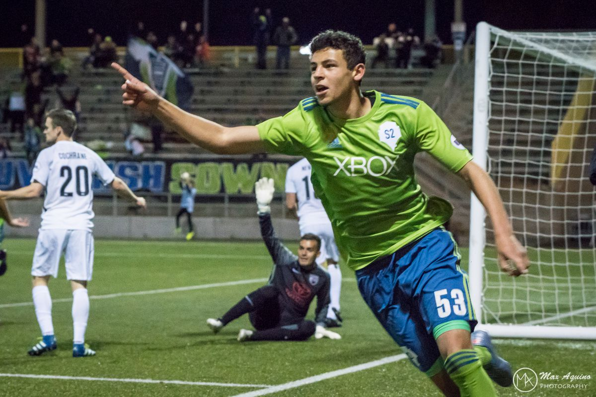 Sam Rogers celebrates after scoring his first professional goal