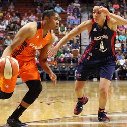 Connecticut Sun's Alex Bentley (20) dribbles past Washington Mystics' Bria Hartley (8).