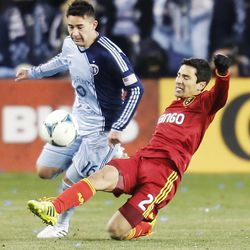 Real's Tony Beltran kicks the ball past Kansas City's Claudio Bieler as Real Salt Lake and Sporting KC play Saturday, Dec. 7, 2013 in MLS Cup action. Sporting KC won in a shootout.