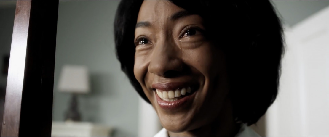 A closeup of Betty Gabriel crying in 'Get Out'