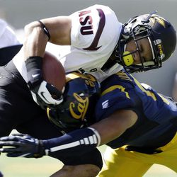 Arizona State running back D.J. Foster is tackled by California's Michael Lowe during the first half of an NCAA college football game in Berkeley, Calif., Saturday, Sept.  29,  2012. (AP Photo/Marcio Jose Sanchez)