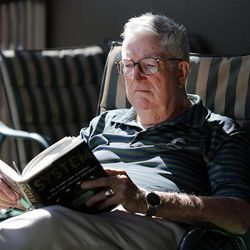 Frank Layden reads at his home in Salt Lake City Tuesday, June 3, 2014.