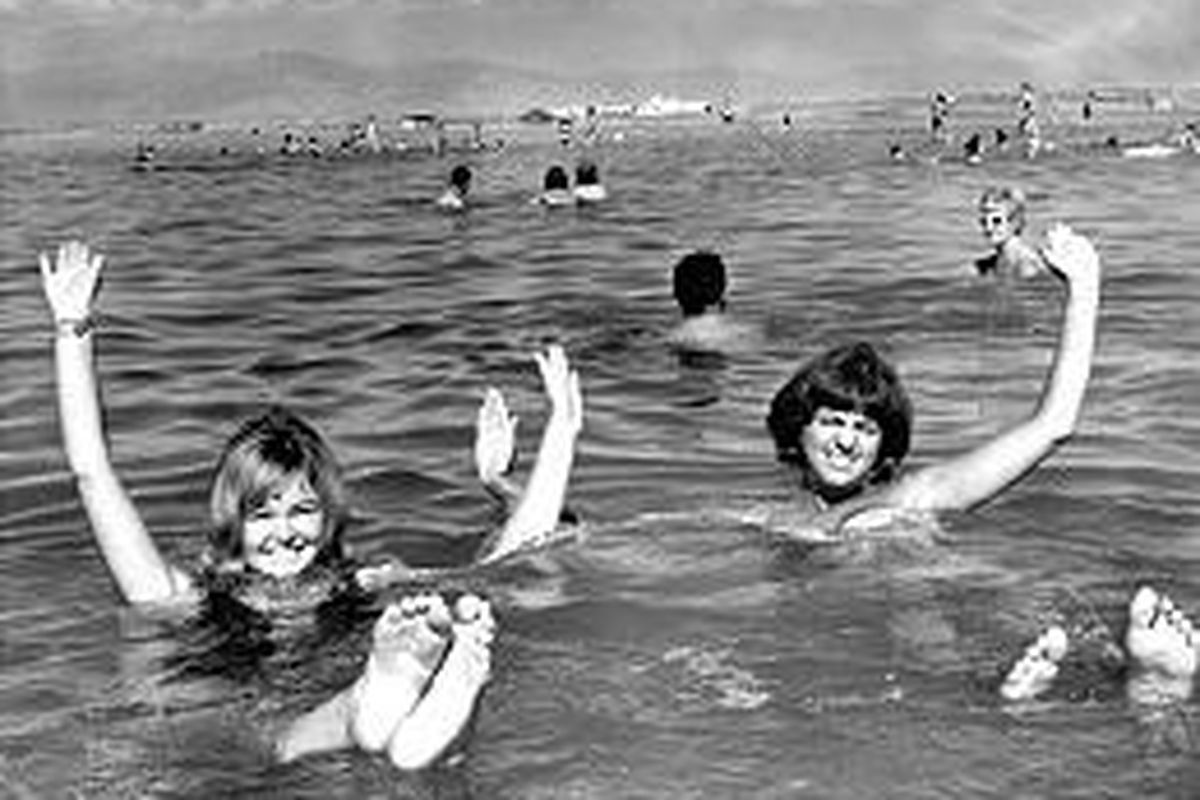 In the 1960s, bathers sit practically upright in the lake's salty waters.