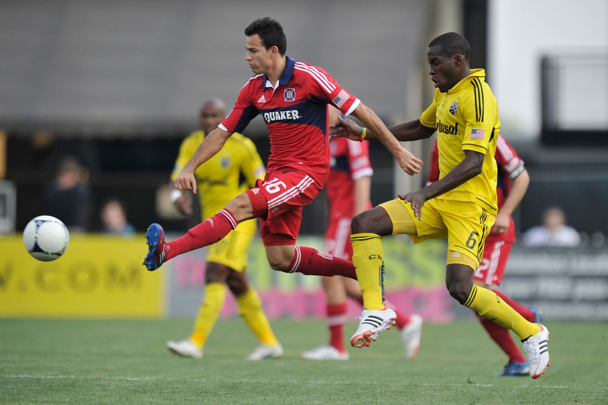 COLUMBUS, OH - MAY 26:  Marco Pappa #16 of the Chicago Fire takes control of the ball in front of Tony Tchani #6 of the Columbus Crew in the first half on May 26, 2012 at Crew Stadium in Columbus, Ohio.   (Photo by Jamie Sabau/Getty Images)