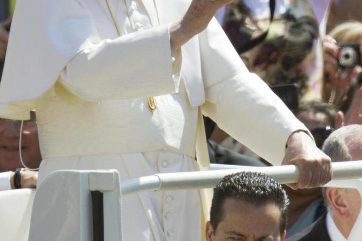 FILE - In this file photo taken Wednesday, May, 23, 2012, Pope Benedict XVI, flanked by his butler Paolo Gabiele, delivers his blessing as he arrives at St.Peter's square at the Vatican for a general audience. Pope Benedict XVI's trusted butler, who dress