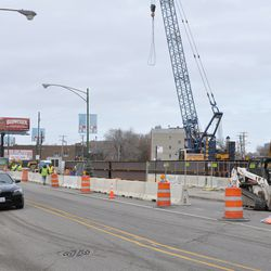 Concrete barriers being moved onto Clark