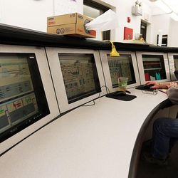 Scrubber operator Brad Orgill works in the scrubber control room at the Huntington power plant in Huntington, Tuesday, March 24, 2015.