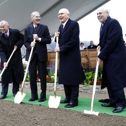 (Left to Right) Elder Steven E. Snow of the Seventy, Elder J E Jensen Presidency of the Seventy, Elder Dallin H. Oaks of the Quorum of the Twelve Apostles, and Elder William R. Walker of the Seventy share a laugh together prior to turning over the first shovels of dirt as thousands turn out in the rain Saturday, Oct. 8, 2011 for the ground breaking for the Payson Temple.