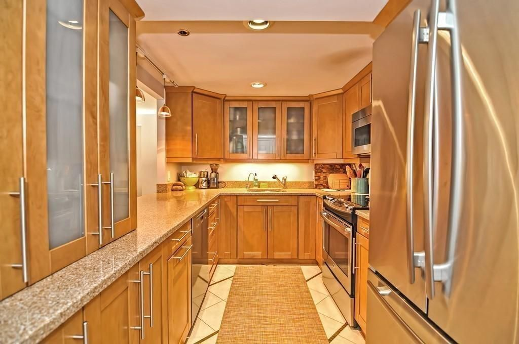 A long kitchen with a u-shaped counter.