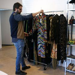 Richard adds another sequined frock to the collection of pieces for the exhibit.