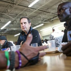 Rep. Norman K. Thurston, R-Provo, talks to two men who are experiencing homelessness, who asked to remain anonymous, at St. Vincent de Paul Dining Hall in Salt Lake City on Tuesday, Sept. 19, 2017.