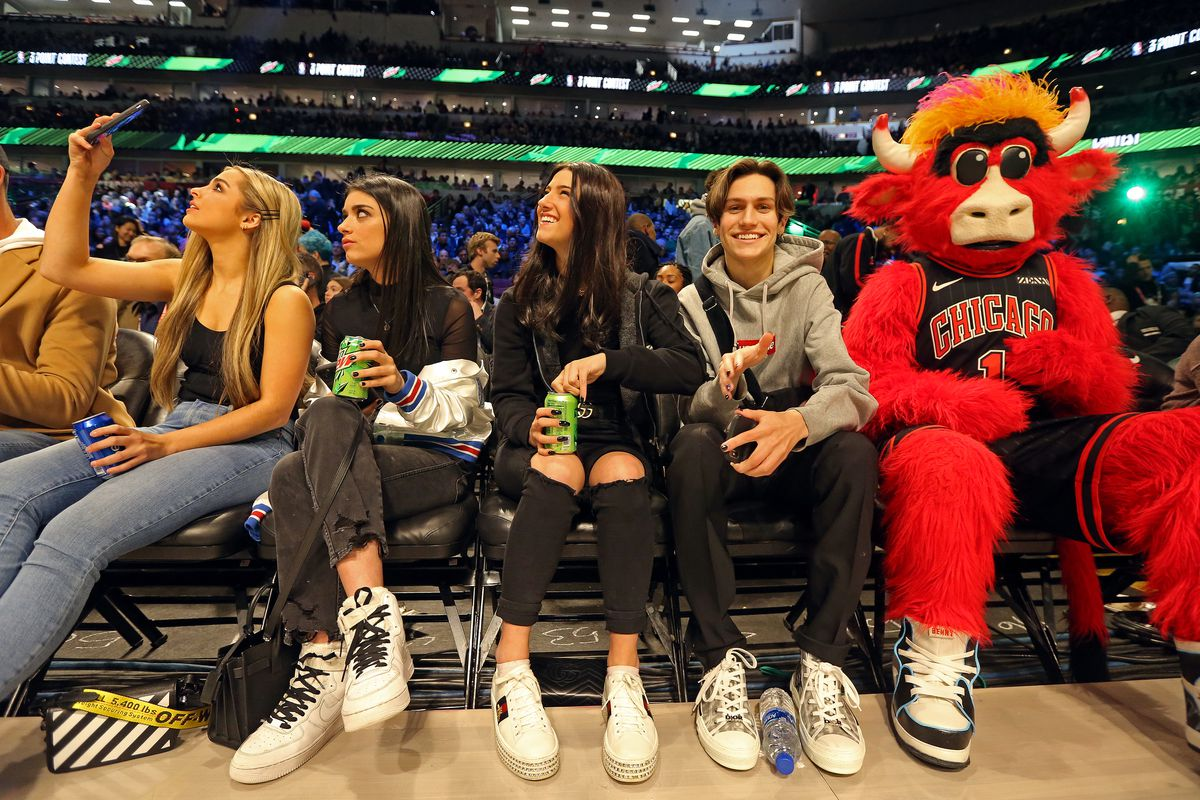 Teen TikTok celebrities sit on the sidelines at the 2020 NBA All-Star Game in Chicago.