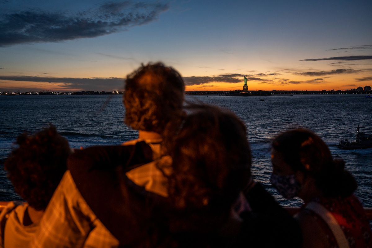 A family gazed upon Lady Liberty during a trip back from Staten Island, May 27, 2021.