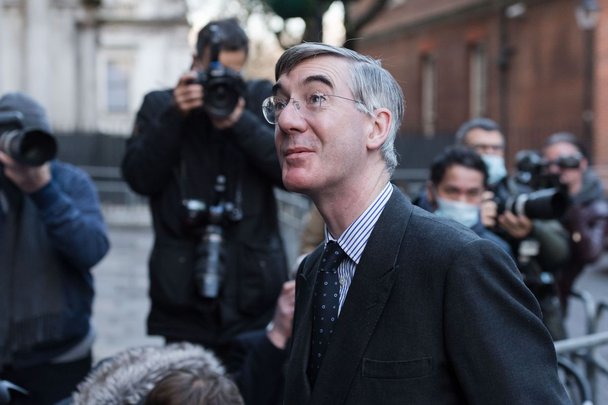 Jacob Rees-Mogg stands outside 10 Downing Street in London