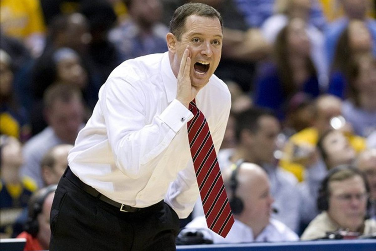 Feb 22, 2012; Milwaukee, WI, USA; Rutgers Scarlet Knights head coach Mike Rice calls out during the first half against the Marquette Golden Eagles at the Bradley Center.  Mandatory Credit: Jeff Hanisch-US PRESSWIRE