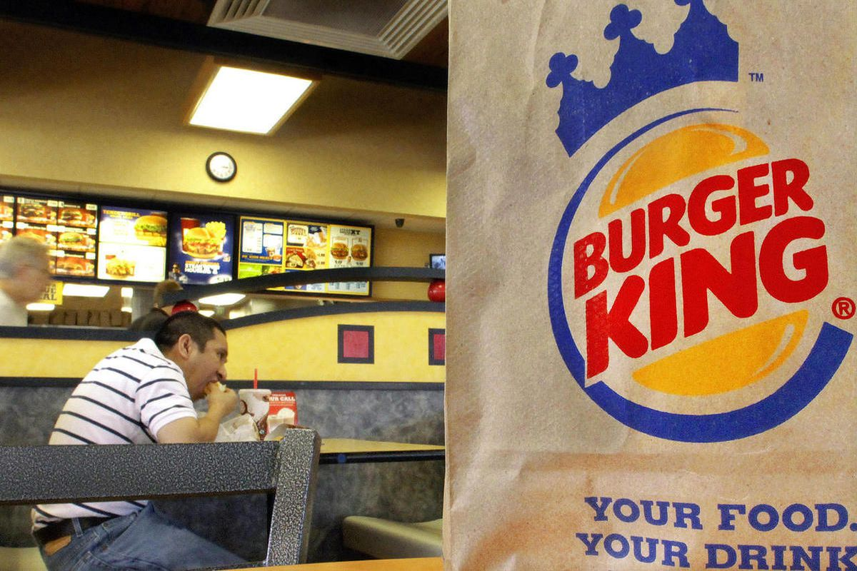 FILE - In this Aug. 24, 2010 file photo, patrons enjoy a meal at a Burger King in Springfield, Ill. The movement by U.S. food corporations toward more humane treatment of animals experienced a whopper of a shift Wednesday, April 25, 2012, when Burger Ki
