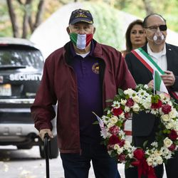 Paul Loparco, 82, of Oak Forest, participates in a wreath laying ceremony with members of the American Legion during the Columbus Day: Italian American Heritage Celebration at Arrigo Park in the Little Italy neighborhood, Monday morning, Oct. 12, 2020.