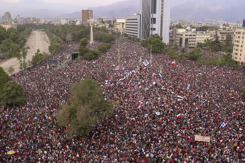 Thousands of demonstrators fill a public plaza in Santiago, Chile.
