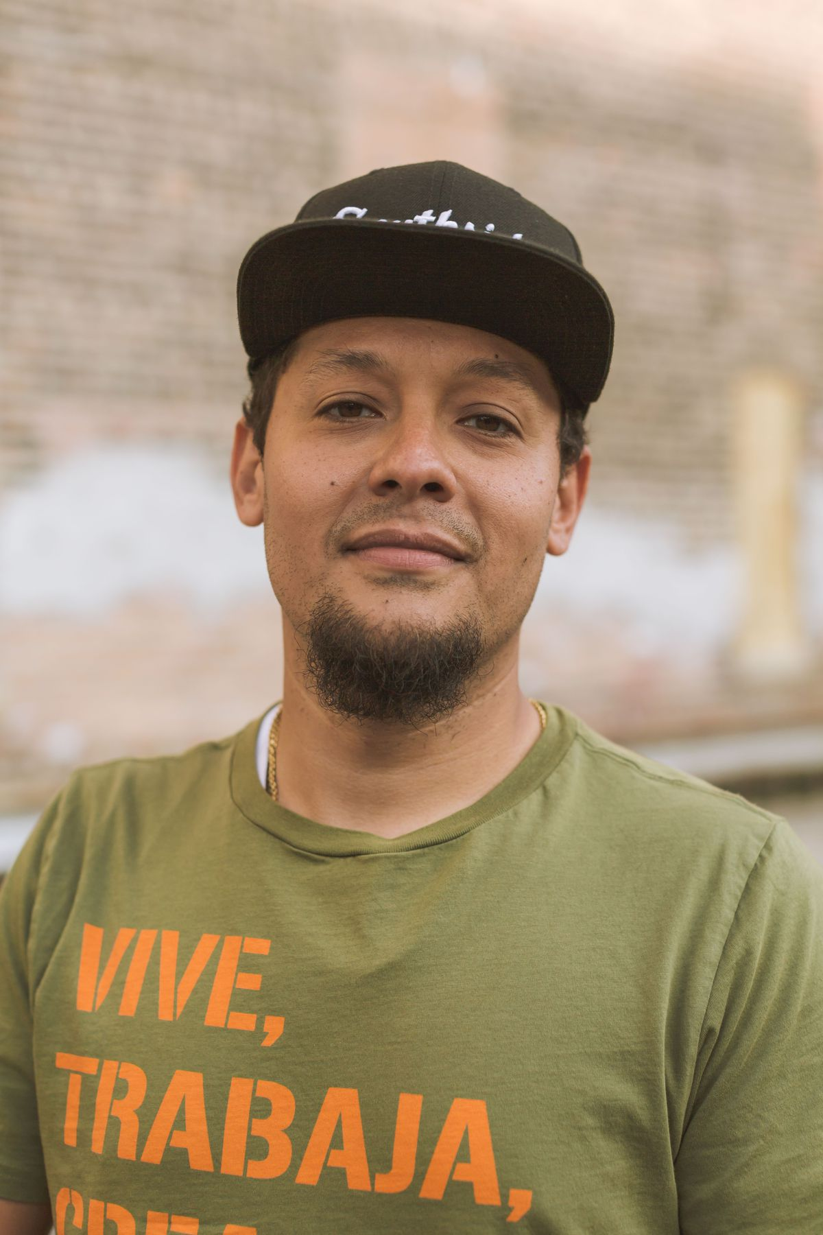 Mateo Zapata, one of the mural's artists, has experienced the effects of gentrification through his rising rent.