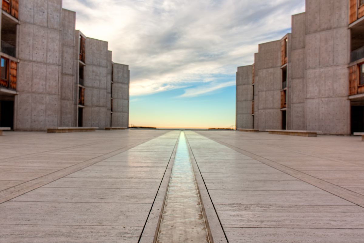 The sunset through buildings at the Salk Institute.