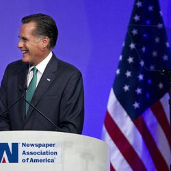 Republican presidential candidate, former Massachusetts Gov. Mitt Romney reacts to a question while speaking at the Newspapers Association of America/ American Society of News Editors luncheon gathering in Washington, Wednesday, April 4, 2012.