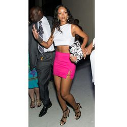Rihanna does a white crop with a very Versace hot pink mini at the <strong>Versus Versace</strong> show.