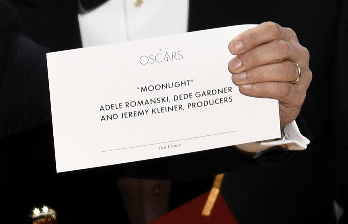 """Jordan Horowitz holds up the envelope that reveals """"Moonlight"""" as the winner of the award for best picture at the Oscars on Sunday, Feb. 26, 2017, at the Dolby Theatre in Los Angeles. (Photo by Chris Pizzello/Invision/AP)"""
