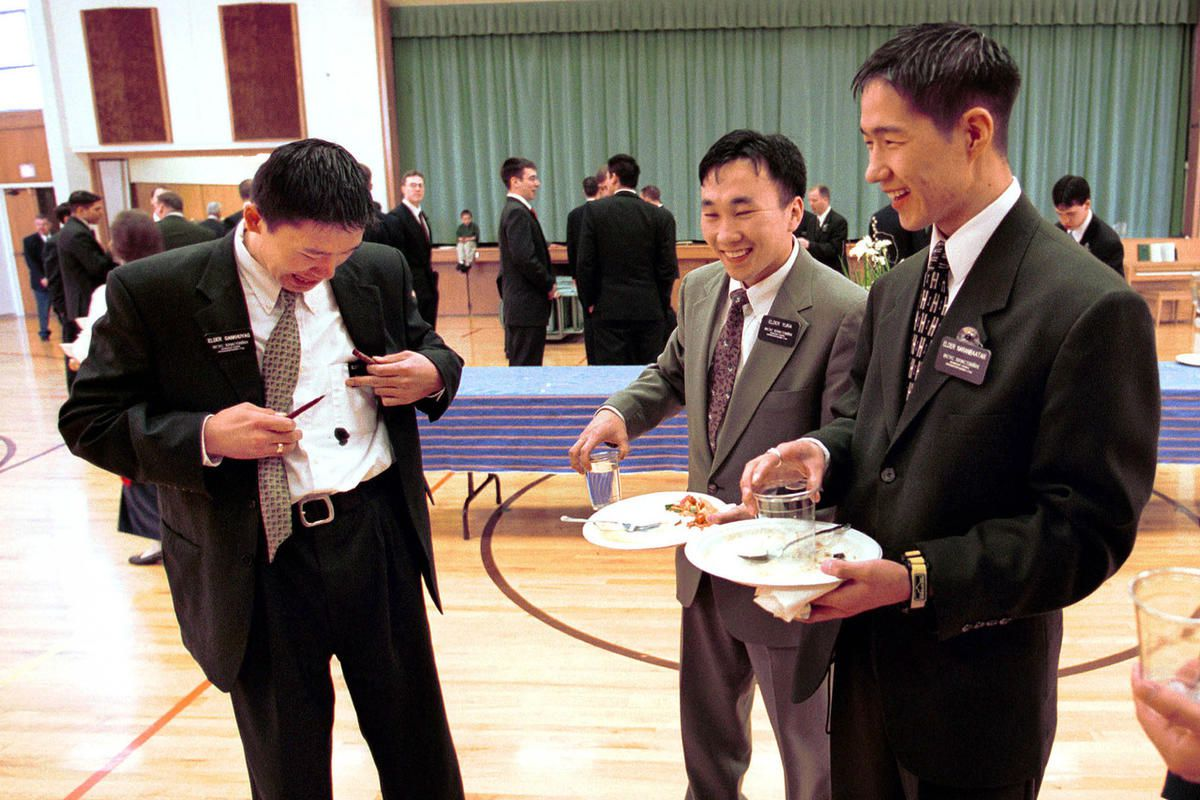 FILE: Elder Ishdorg Gankhuyag is dismayed after his pen ink leaked through his shirt pocket as Elder's Enkhtogtekh Yura and Enkhebaa Naranbaatar share a laugh during a Church of Jesus Christ of Latterday Saints missionary zone conference in Salt Lake City