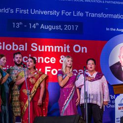 Students sing the United States National Anthem durin  an  award ceremony in Pune, Maharashtra, India on August 14, 2017.