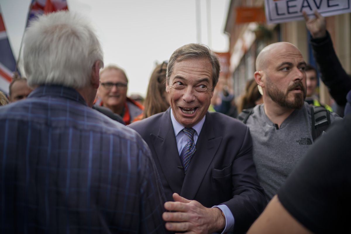 Former UKIP leader Nigel Farage arrives at the Last Post pub during the March to Leave protest in Nottingham on March 23, 2019.
