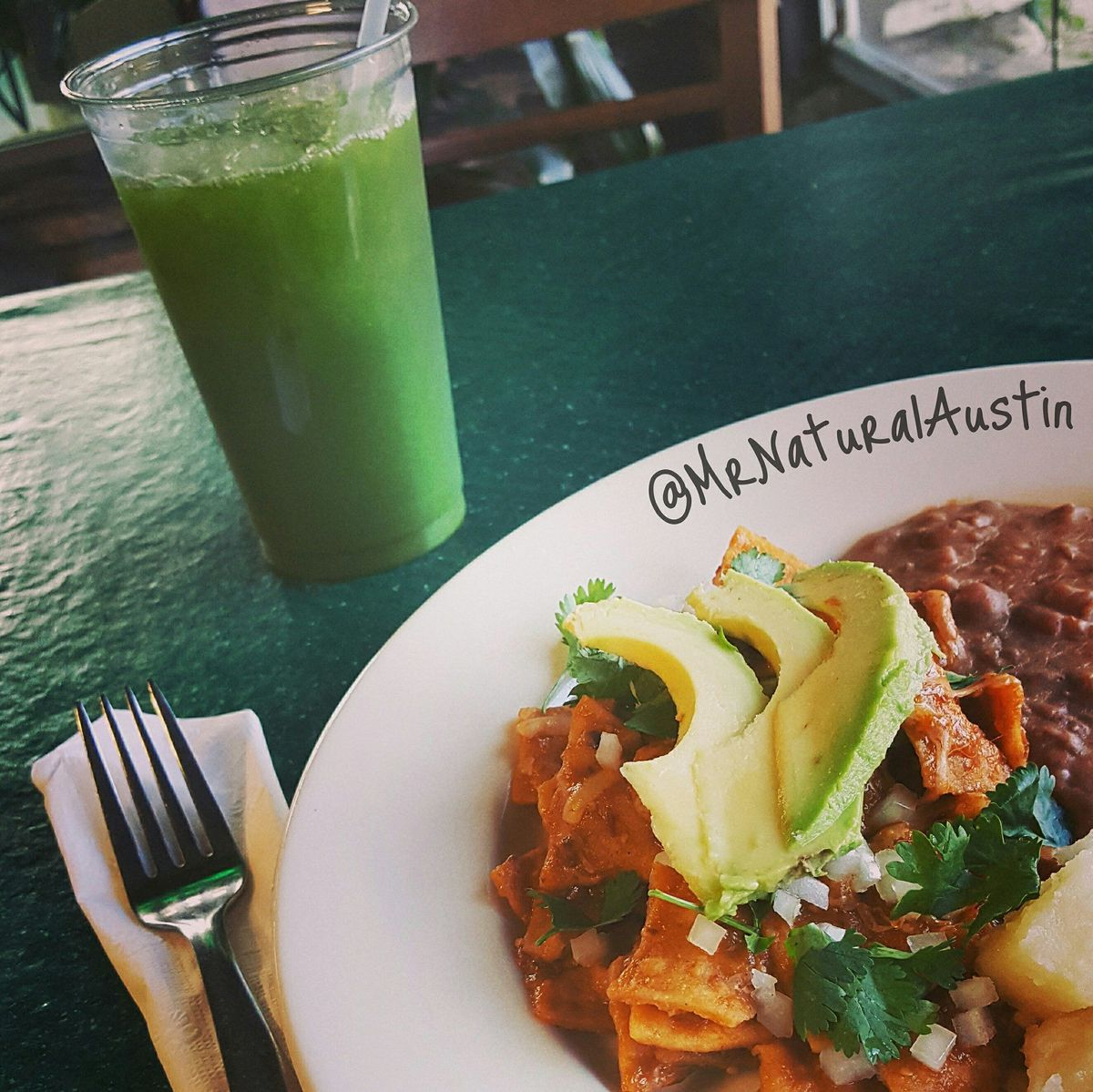 Green drink, closeup of plate with Tex-Mex and avocado slices on plate