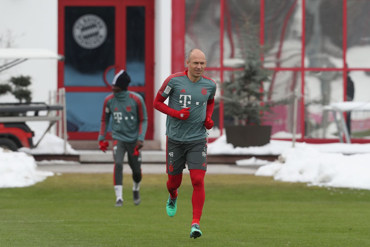 MUNICH, GERMANY - FEBRUARY 07: Arjen Robben (R) and Alphonso Davies of FC Bayern Muenchen arrive for a training session at the club's Saebener Strasse training ground on February 7, 2019 in Munich, Germany.
