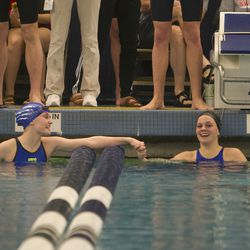 Sky View High School's Megan Brimhall, left, and Cottonwood High School's Rhyan White, right, congratulate each other after the women's 100-yard backstroke during the 2016 UHSAA Class 5A State Swimming Championships Friday, Feb. 12, 2016, at the Stephen L. Richards building in Provo.