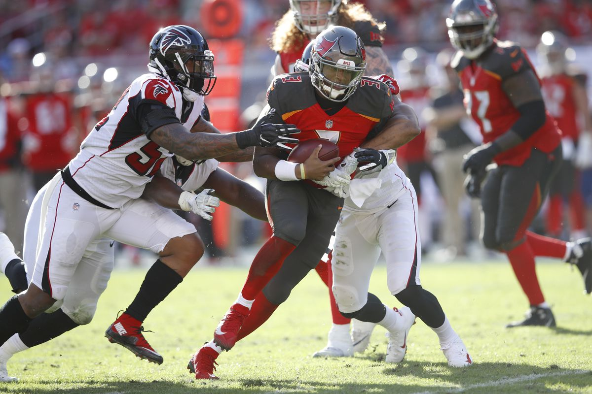 Jameis Winston of the Tampa Bay Buccaneers gets sacked by Vic Beasley Jr. and Bruce Irvin of the Atlanta Falcons during the game at Raymond James Stadium on December 30, 2018 in Tampa, Florida.